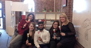 Photo of UniQuest team with UQ marshmallow pops