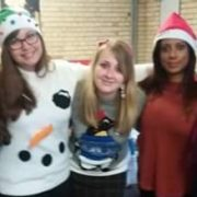 Photo of UniQuest team members in festive outfits