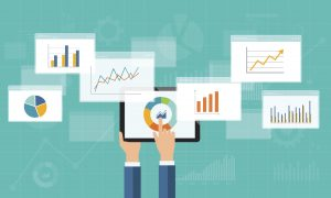 Blog feature image of 7 analytics dashboards on handheld device
