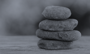 Image of stacked stones representing well-being