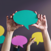 Photo of students holding up speech bubbles